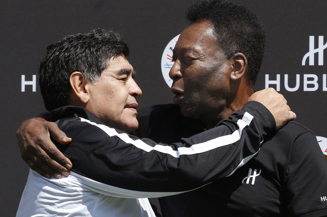 (FILES) In this file photo taken on June 09, 2016 former Argentinian football international Diego Maradona (L) and former Brazilian footballer Pele pose after a football match organised by Swiss luxury watchmaker Hublot at the Jardin du Palais Royal in Paris, on the eve of the Euro 2016 European football championships. - Argentinian football legend Diego Maradona passed away on November 25, 2020. (Photo by PATRICK KOVARIK / AFP)